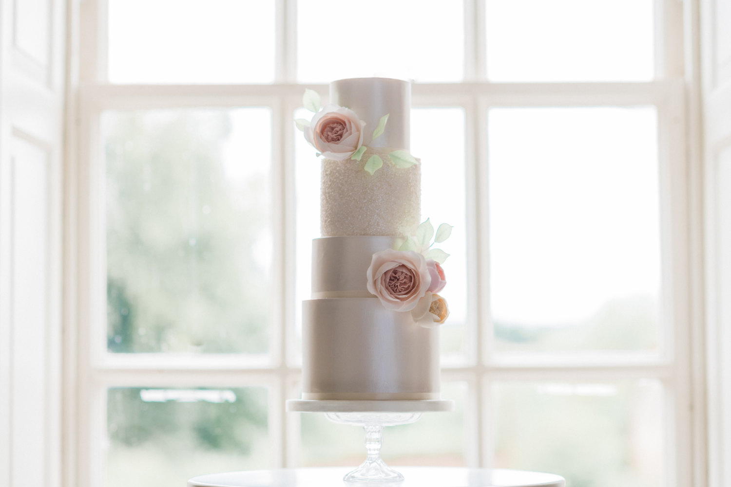 Wedding cake in front of a window