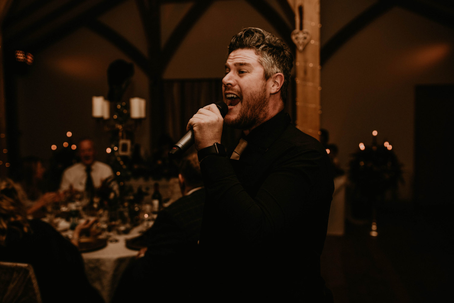 Man singing into a microphone