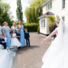 Bride showing people her dress