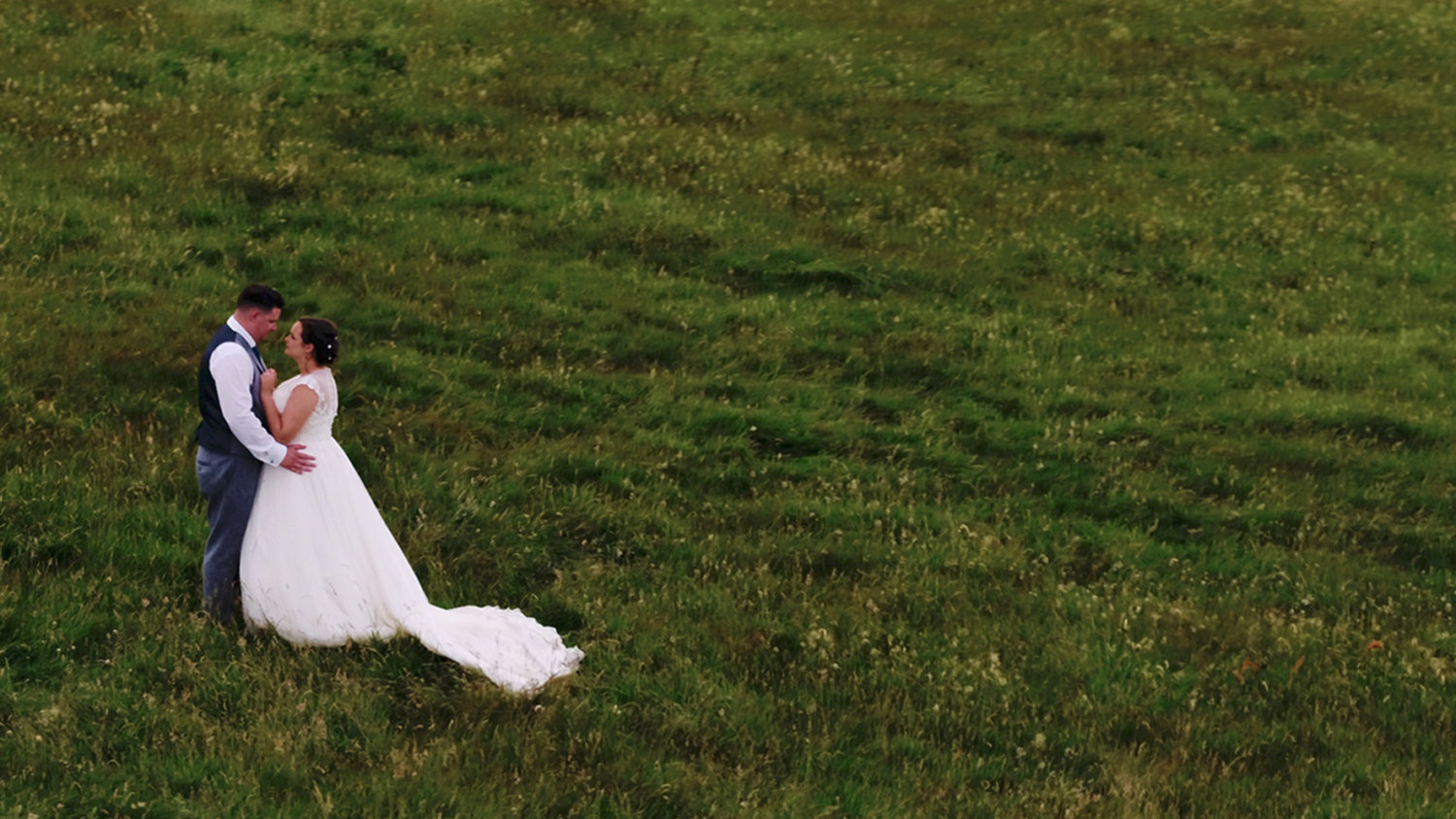 bride and a groom in a field