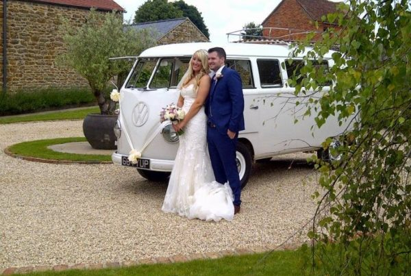 Bride and groom in front of a VW van