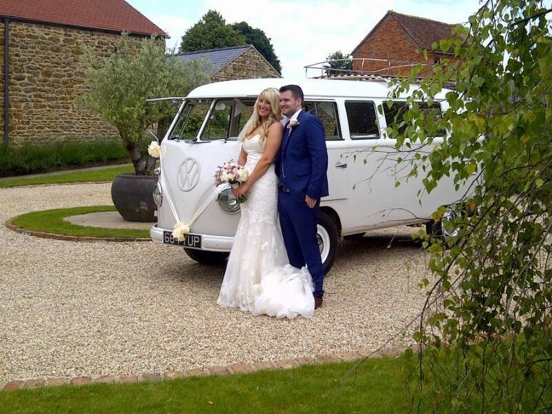 Bride and groom in front of a VW van