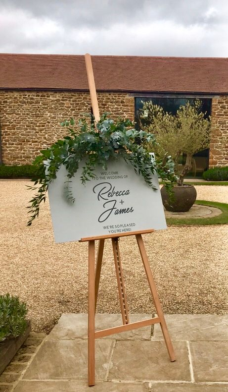 Sign for a wedding outside of a barn