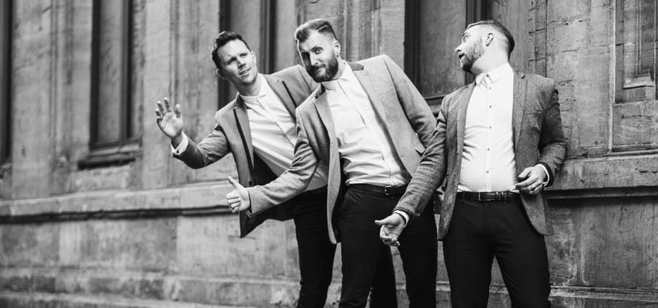 Three men posing for a picture