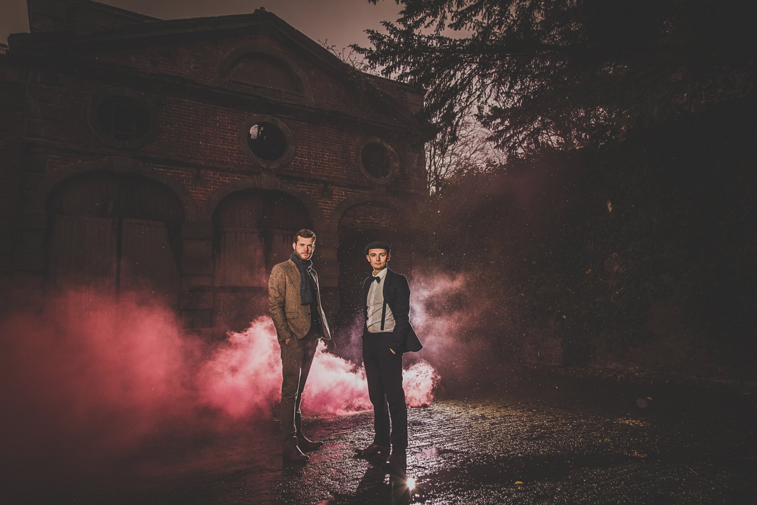 Two men outside an abandoned building