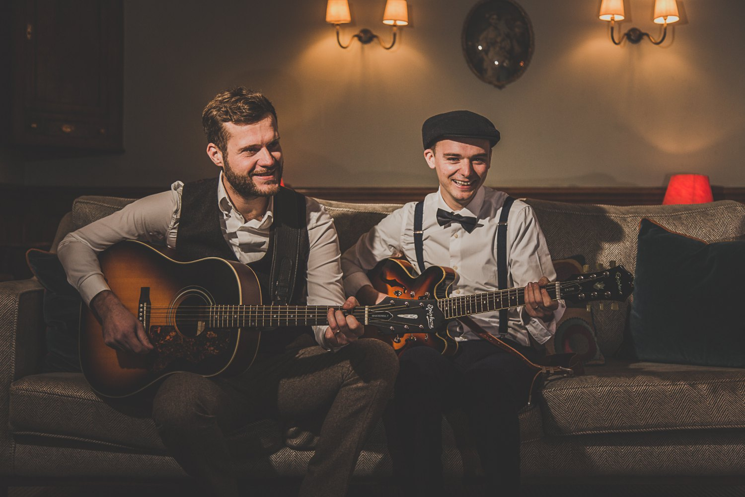 Two men playing the guitar