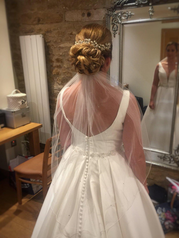 ride in her wedding dress