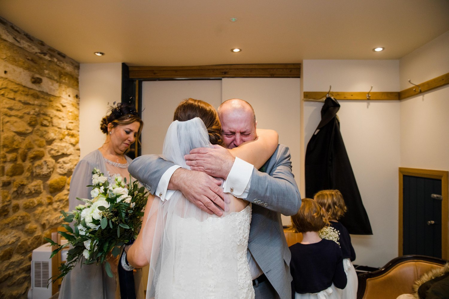 Bride and her father hugging
