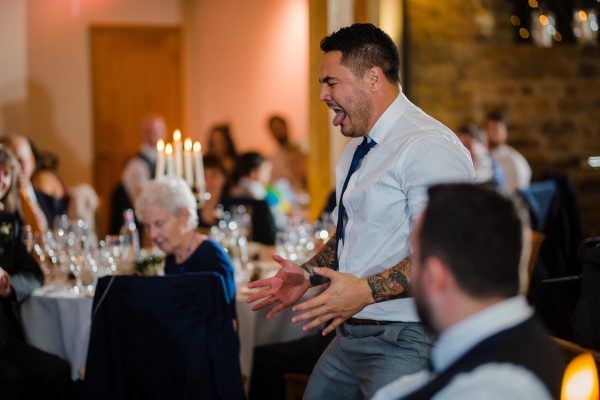 man doing the haka at a wedding