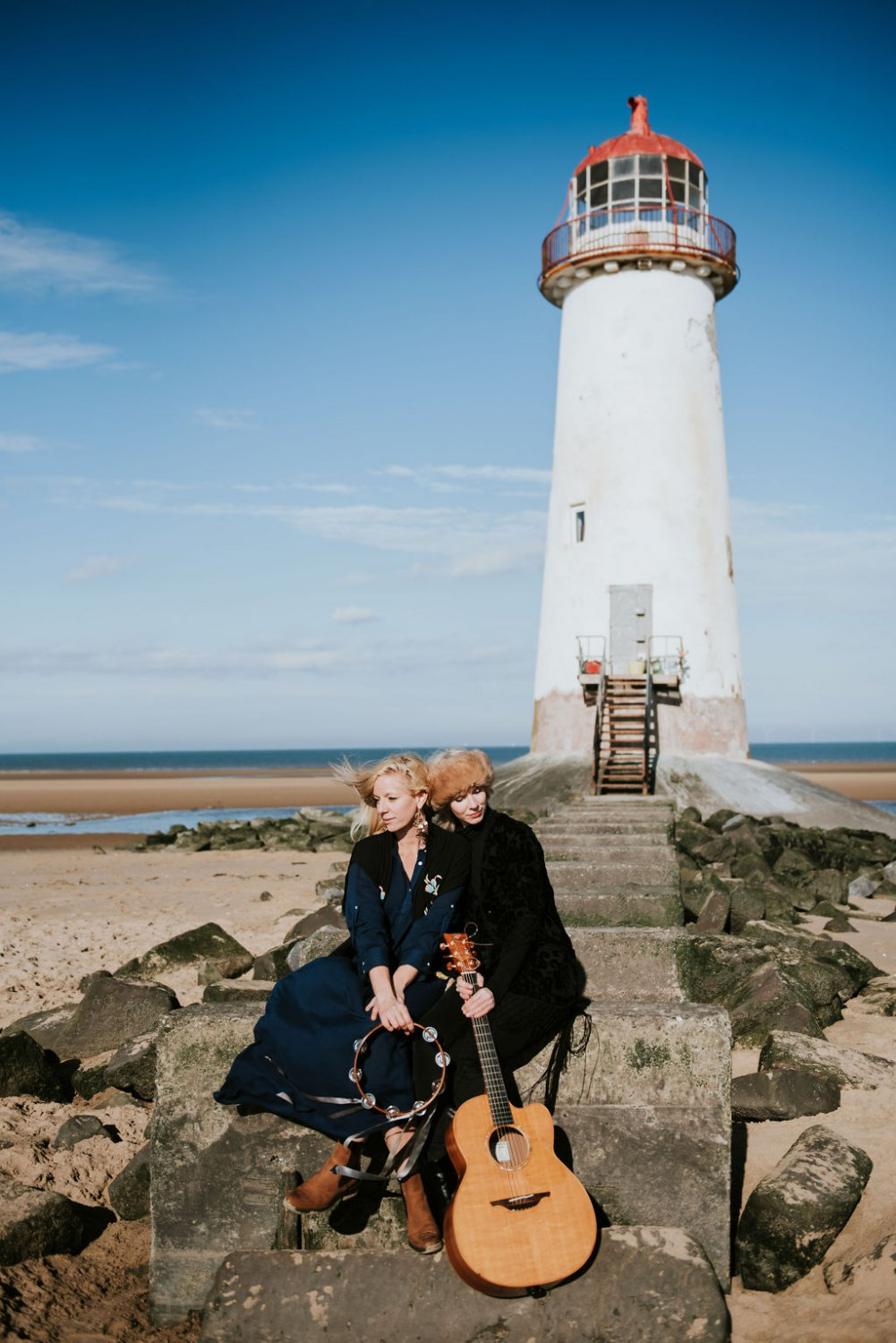 Two women outside a lighthouse