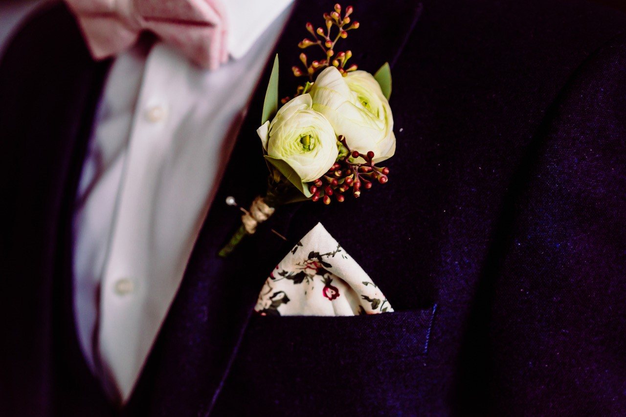Close up of a grooms suit