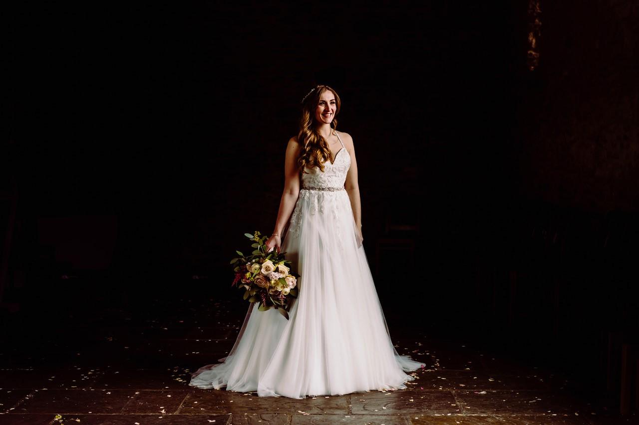 Bride standing in the darkness