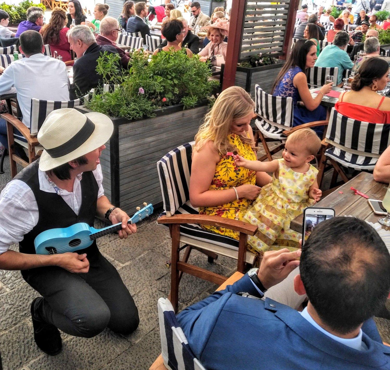 Man playing guitar at a table